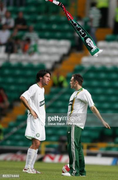 Celtic's Rocco Quinn watches a fan throw away his scarf after running onto the pitch following their 30 loss to Manchester United in the friendly...