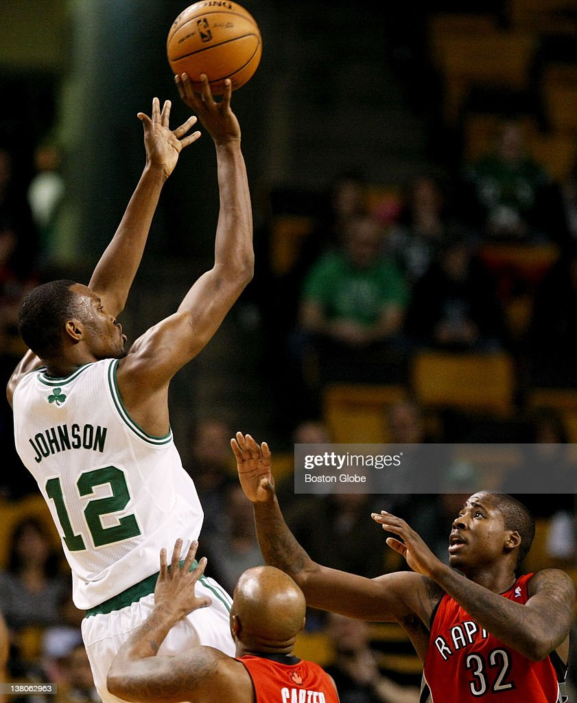 Celtics rookie forward JaJuan Johnson (#12) hits a jumper in the 4th quarter over Raptors guard Anthony Carter (#25) and forward Ed Davis (#32) in the 4th quarter. Johnson was 5 for 5 with 11 points - a season and career high. The Celtics win 100-64. The Boston Celtics play the Toronto Raptors at the TD Garden in a regular season NBA game in Boston, Mass. on Wednesday, Feb. 1, 2012.