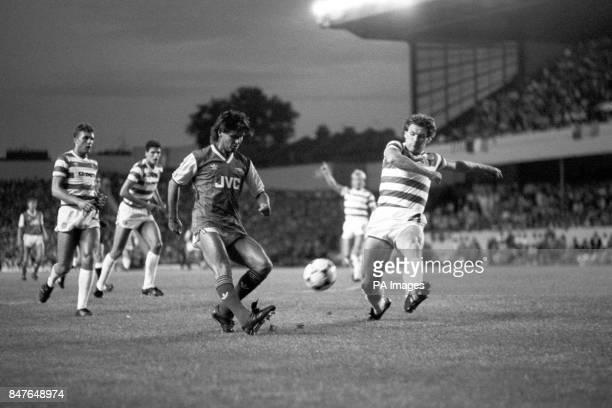 Celtic's Roy Aitken tries to stop former teammate Charlie Nicholas from getting in a shot for Arsenal