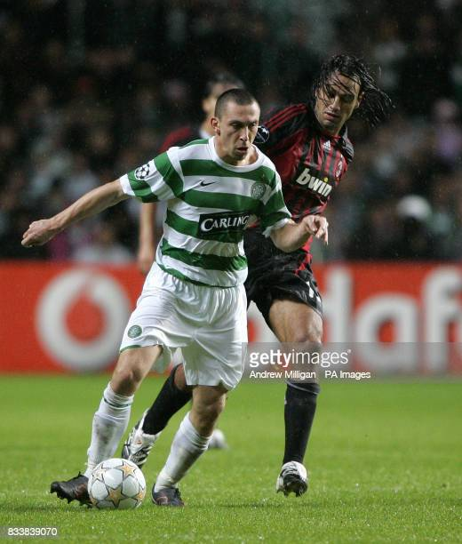 Celtic's Scott Brown and AC Milan's Alessandro Nesta battle for the ball