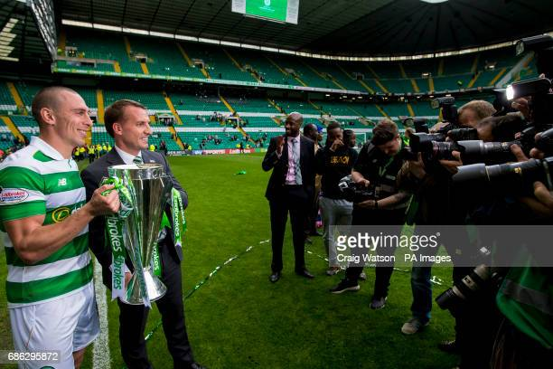 Celtic's Scott Brown and manager Brendan Rogers lifts the trophy during the Ladbrokes Scottish Premiership match at Celtic Park Glasgow