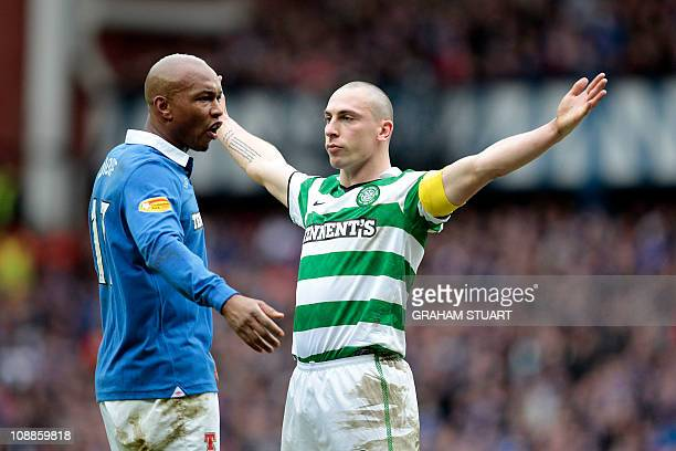 Celtic's Scott Brown celebrates scoring against Rangers' Senegalese striker ElHadji Diouf during a Scottish FA Cup football match at Ibrox Stadium...