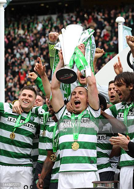 Celtic's Scott Brown celebrates with the league trophy following the Clydesdale Bank Premier League match between Celtic and Hearts at Celtic Park on...