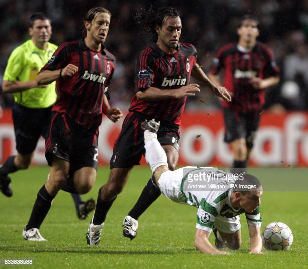 Celtic's Scott Brown is upended by AC Milan's Alessandro Nesta and Massimo Ambrosini