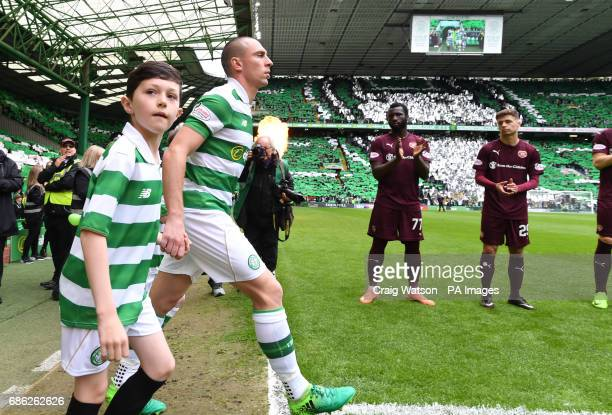 Celtic's Scott Brown leads his team through a guard of honour before the Ladbrokes Scottish Premiership match at Celtic Park Glasgow