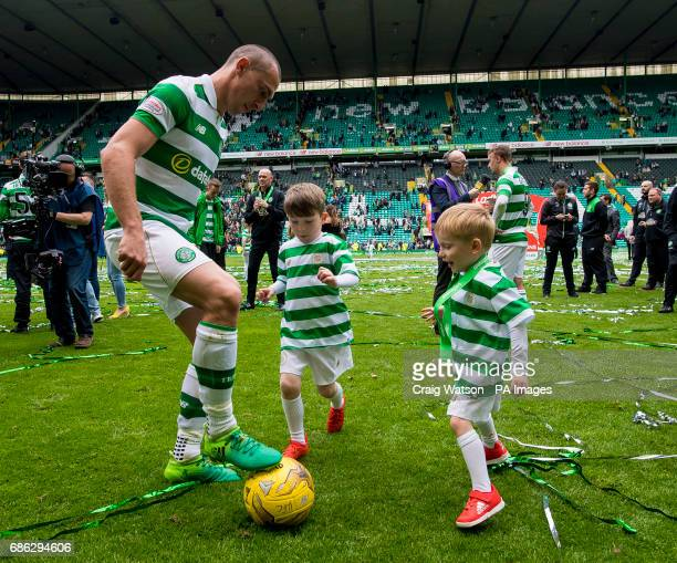Celtic's Scott Brown plays football with his children during the Ladbrokes Scottish Premiership match at Celtic Park Glasgow