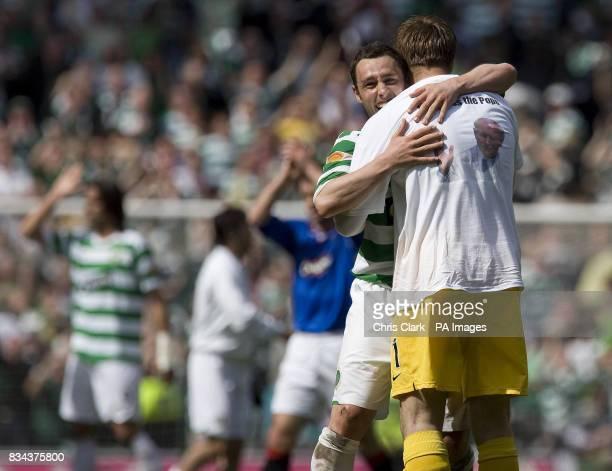 Celtic's Scott McDonald and Artur Boruc celebrate defeating Rangers during the Clydesdale Bank Premier League match at Celtic Park Glasgow