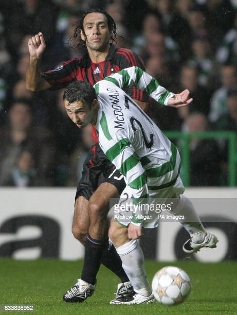 Celtic's Scott McDonald challenges AC Milan's Alessandro Nesta