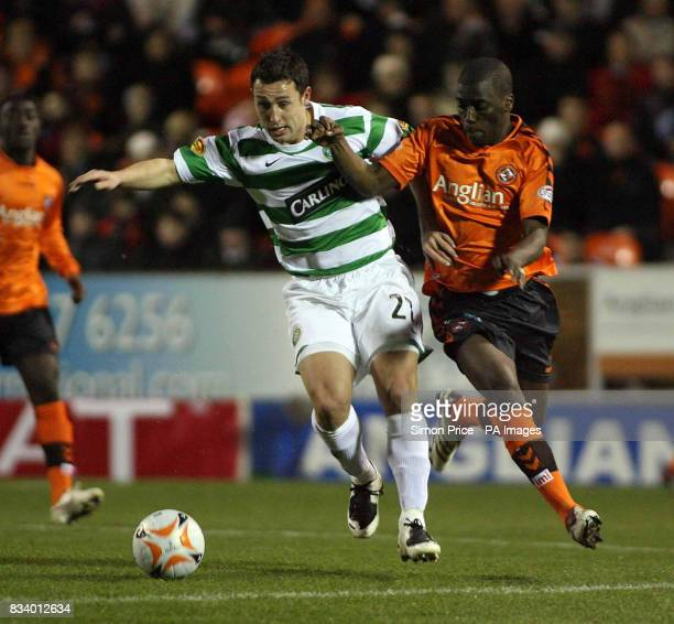 Celtic's Scott McDonald in action with Dundee United's Morgaro Gomis during the Clydesdale Bank Scottish Premier League match at Tannadice Park Dundee