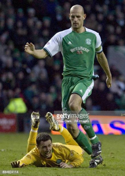 Celtic's Scott McDonald lies at the feet of Hibernian captain Rob Jones claiming he was fouled during the Clydesdale Bank Scottish Premier League...
