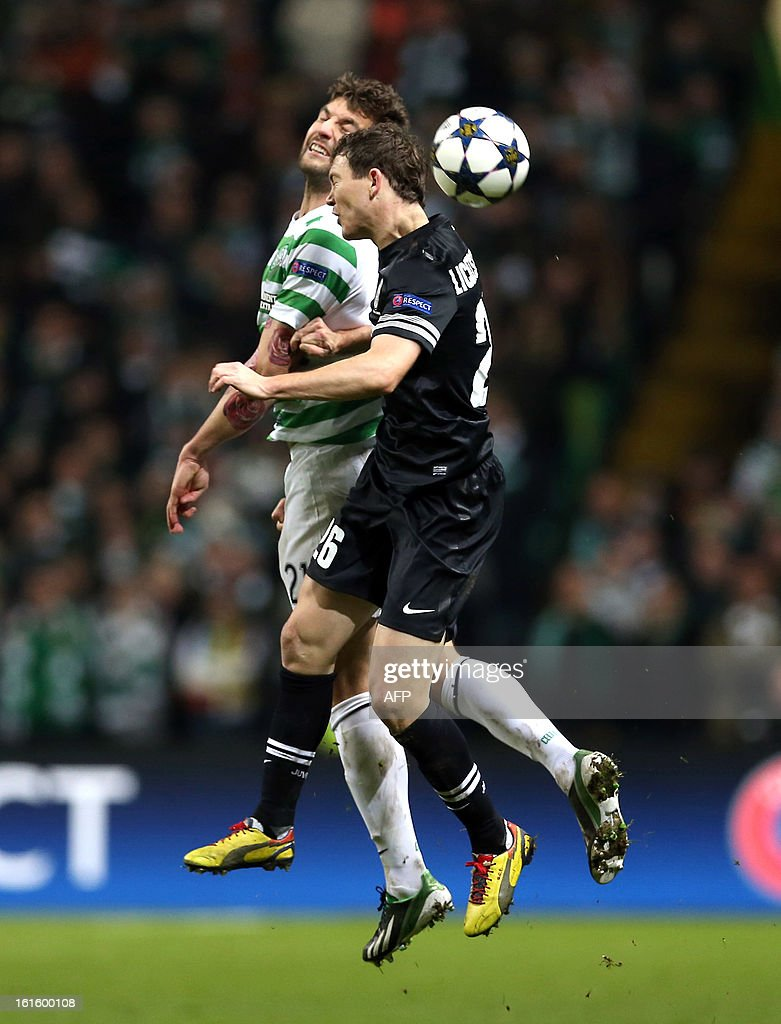 Celtic's Scottish defender Charlie Mulgrew (L) competes with Juventus's Swiss forward Stephan Lichtsteiner during the UEFA Champions League last sixteen football match between Celtic and Juventus at Celtic park in Glasgow, Scotland, on February 12, 2013. Juventus won the match 3-0.