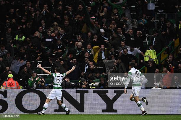 Celtic's Scottish defender Kieran Tierney celebrates scoring his team's second goal from a deflection by Manchester City's English midfielder Raheem...