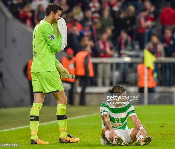 Celtic's Scottish goalkeeper Craig Gordon and Celtic's Costa Rican defender Cristian Gamboa react after the Champions League group B match between FC...