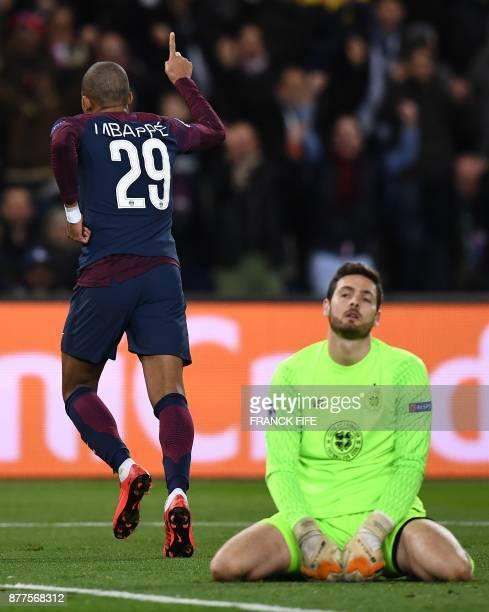 Celtic's Scottish goalkeeper Craig Gordon looks on as Paris SaintGermain's French striker Kylian Mbappe celebrates scoring his team's fourth goal...