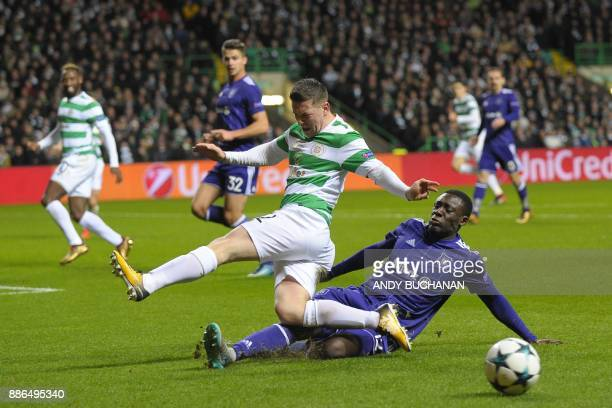 Celtic's Scottish midfielder Callum McGregor is tackled by Anderlecht's French defender Dennis Appiah during the UEFA Champions League Group B...