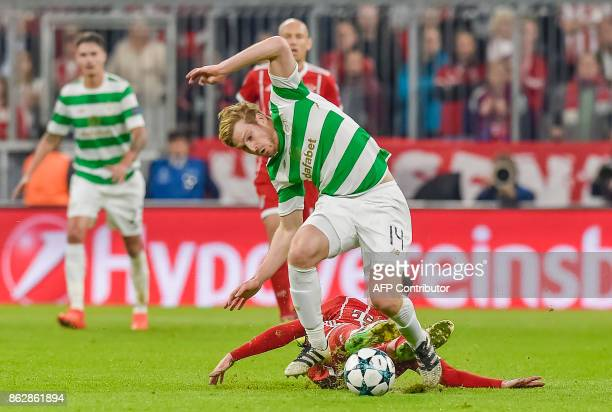 Celtic's Scottish midfielder Stuart Armstrong and Bayern Munich's German midfielder Sebastian Rudy vie for the ball during the Champions League group...