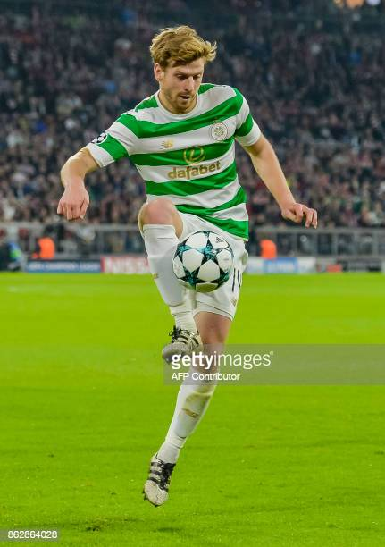 Celtic's Scottish midfielder Stuart Armstrong controls the ball during the Champions League group B match between FC Bayern Munich and Celtic Glasgow...