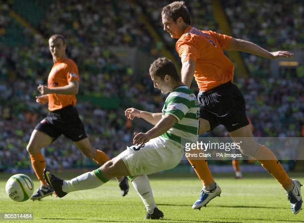 Celtic's Shaun Maloney crosses the ball as Dundee United defender Andy Webster tries to make a tackle during the Clydesdale Bank Scottish Premier...