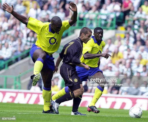 Celtics Shaun Maloney gets between Arsenal's Sol Campbell and Kolo Toure during their preseason friendly between Celtic and Arsenal at Celtic Park...