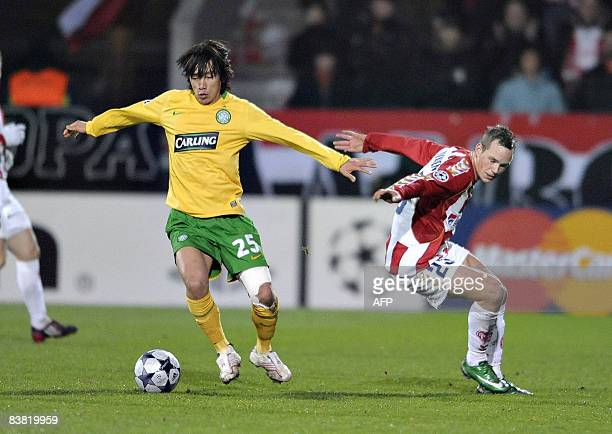 Celtic's Shunsuke Nakamura fights for the ball with Aalborg's Thomas Enevoldsen during the Uefa Champions League group E football match in Aalborg on...