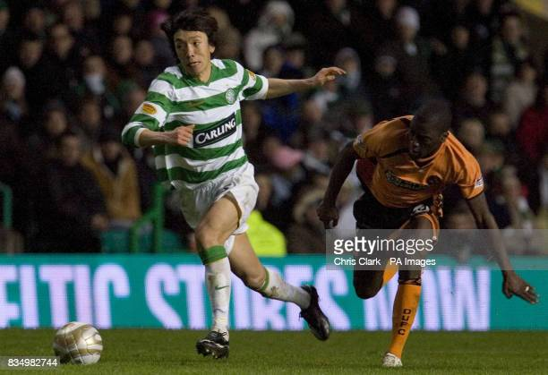 Celtic's Shunsuke Nakamura gets away from Dundee United's Morgaro Gomis during the Clydesdale Bank Premier League match at Celtic Park Glasgow