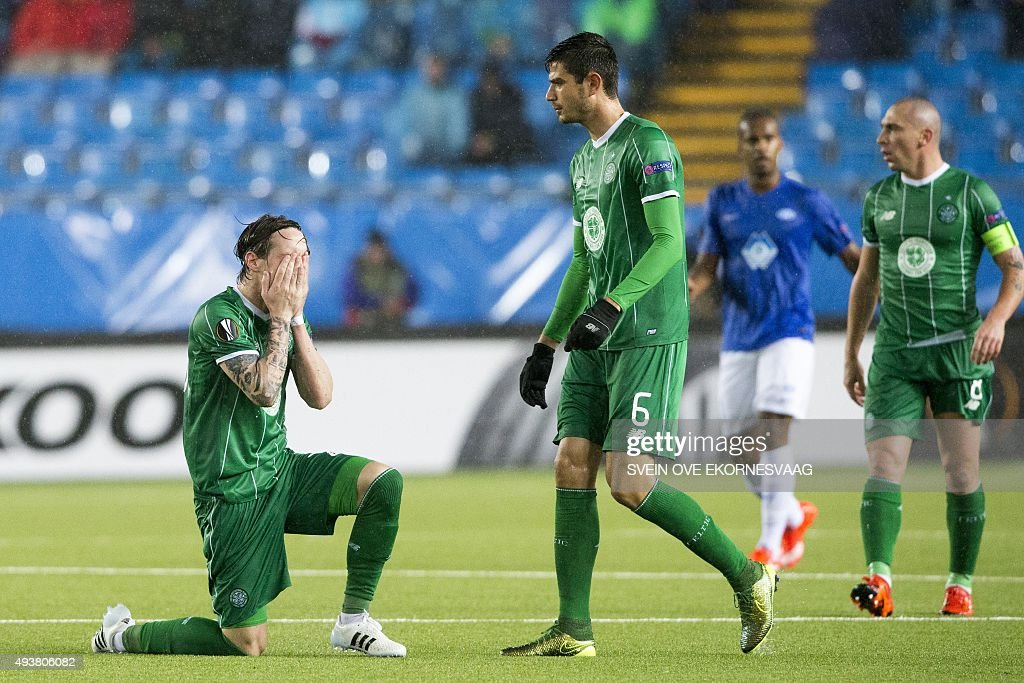 Celtic's Stefan Johansen (L), Nir Bitton (C) and Scott Brown (R) react during the UEFA Europa League Group A football match between Molde FK vs Celtic FC at the Aker Stadium in Molde on October 22, 2015.