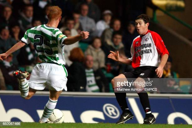 Celtic's Stephen Crainey crosses the ball as he is closed down by Feyenoord's Brett Emerton