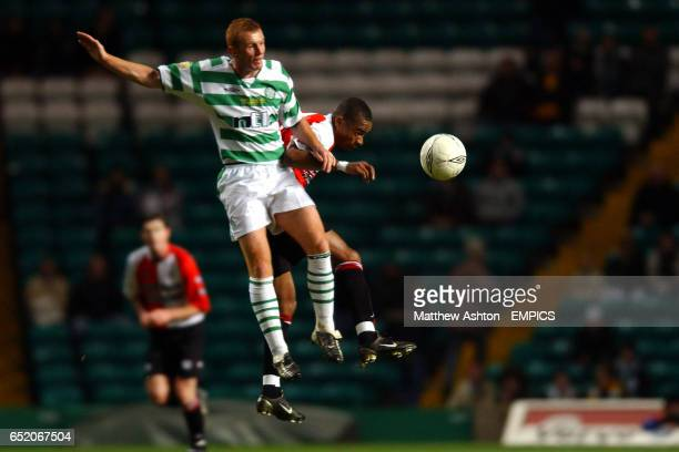 Celtic's Stephen Crainey jumps for a header with Feyenoord's Bonaventure Kalou