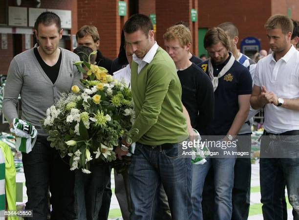Celtic's Stephen McManus and John Kennedy lay a wreath for Tommy Burns at Celtic Park Glasgow