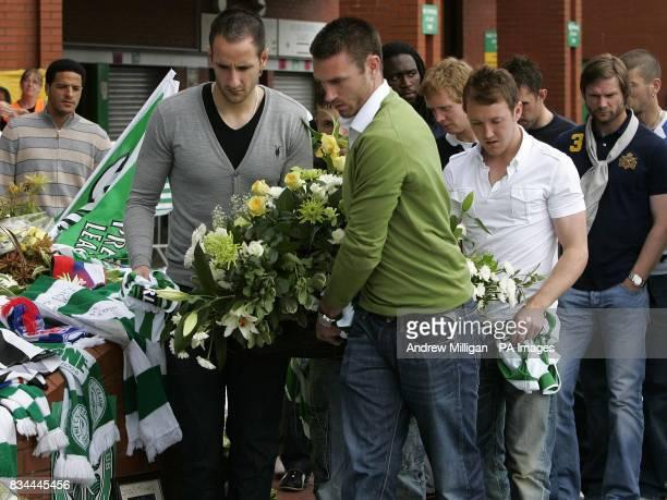 Celtic's Stephen McManus John Kennedy and Stephen McGeady lay a wreath for Tommy Burns at Celtic Park Glasgow