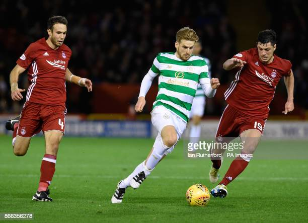 Celtic's Stuart Armstrong and Aberdeen's Scott McKenna battle for the ball during the Scottish Premiership match at Pittodrie Stadium Aberdeen