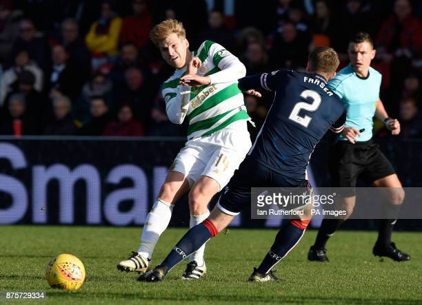 Celtic's Stuart Armstrong and Ross County's Marcus Fraser during the Ladbrokes Scottish Premiership match at the Global Energy Stadium Dingwall