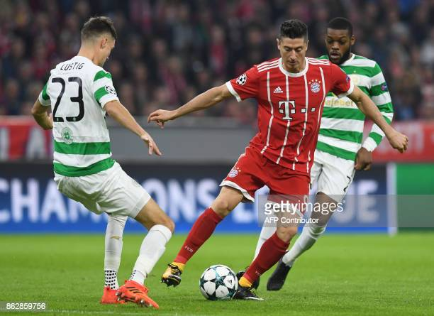 Celtic's Swedish defender Mikael Lustig Bayern Munich's Polish striker Robert Lewandowski and Celtic's French midfielder Olivier Ntcham vie for the...