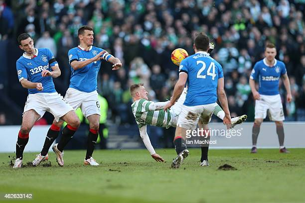 Celtic's Swedish forward John Guidetti performs an over head kick during the Scottish League Cup SemiFinal football match between Celtic and Rangers...