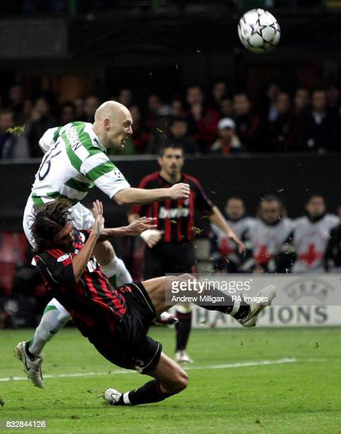 Celtic's Thomas Graveson has a shot whilst being challenged by AC Milan's Paulo Maldini during the UEFA Champions League First Knockout Round Second...