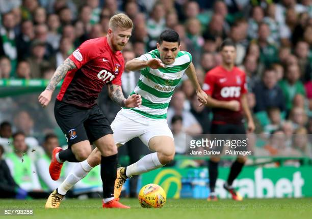 Celtic's Tom Rogic and Kilmarnock's Alan Power battle for the ball during the Betfred Cup Second Round match at Celtic Park Glasgow