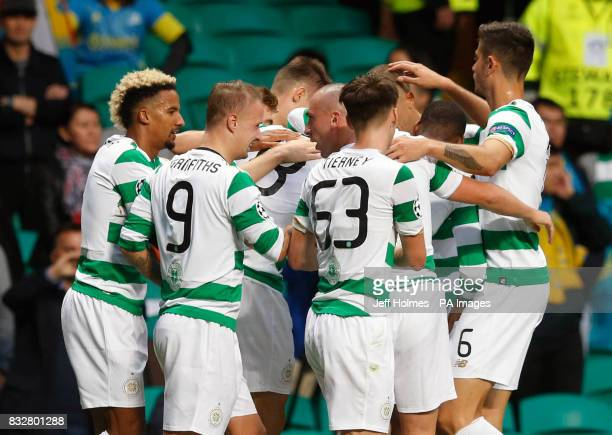 Celtic's Tom Rogic celebrates scoring his side's first goal of the game with teammates during the UEFA Champions League PlayOff First Leg match at...
