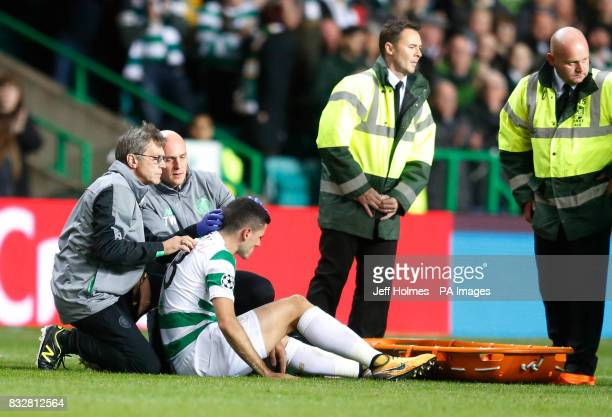 Celtic's Tom Rogic receives treatment for a head injury before being substituted during the UEFA Champions League PlayOff First Leg match at Celtic...