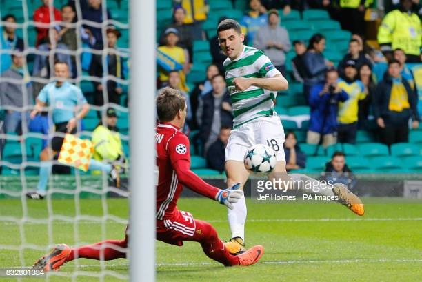 Celtic's Tom Rogic scores his side's first goal of the game during the UEFA Champions League PlayOff First Leg match at Celtic Park Glasgow
