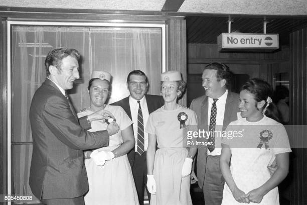 Celtic's Tommy Gemmell Bobby Murdoch and Manager Jock Stein present Air France stewardesses with Celtic rosettes before flying off Lyon France The...