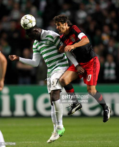 Celtic's Victor Wanyama and Benfica's Pablo Aimar battle for possession of the ball in the air