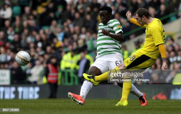 Celtic's Victor Wanyama and Hibernian's Kevin Thomson battle for the ball during the Clydesdale Bank Scottish Premier League match at Celtic Park...