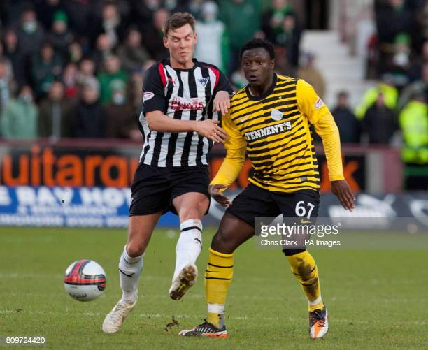Celtic's Victor Wanyama is tackled by Dunfermline's Andy Barrowman during the Clydesdale Bank Scottish Premier League match at East End Park...