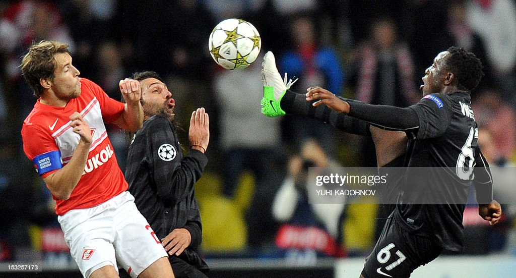 Celtic's Victor Wanyama (R) vies for the ball with Dmitri Kombarov (L) of Spartak Moskva during their UEFA Champions League group G football match at the Luzhniki stadium in Moscow on October 2, 2012.