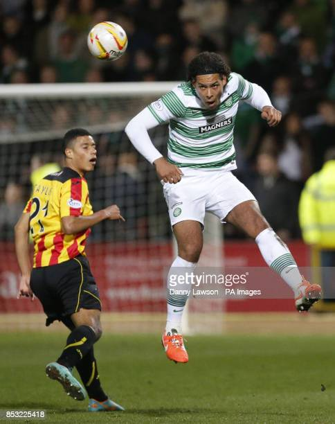 Celtic's Virgil van Dijk beats Partick's Thistle's Lyle Taylor to the ball during the Scottish Premier League match at Firhill Stadium Glasgow