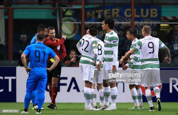 Celtic's Virgil van Dijk is shown his second yellow card by referee Ivan Kruzliak which earns him a red card