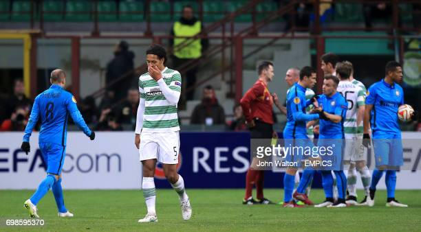 Celtic's Virgil van Dijk walks off the pitch dejected after he is shown his second yellow card by referee Ivan Kruzliak which earns him a red card