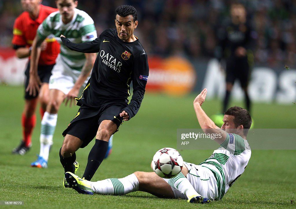 Celtic's Welsh defender Adam Mathews (R) challenges Barcelona's Spanish forward Pedro Rodriguez during their UEFA Champions League Group H football match at Celtic Park in Glasgow, Scotland, on October 1, 2012.