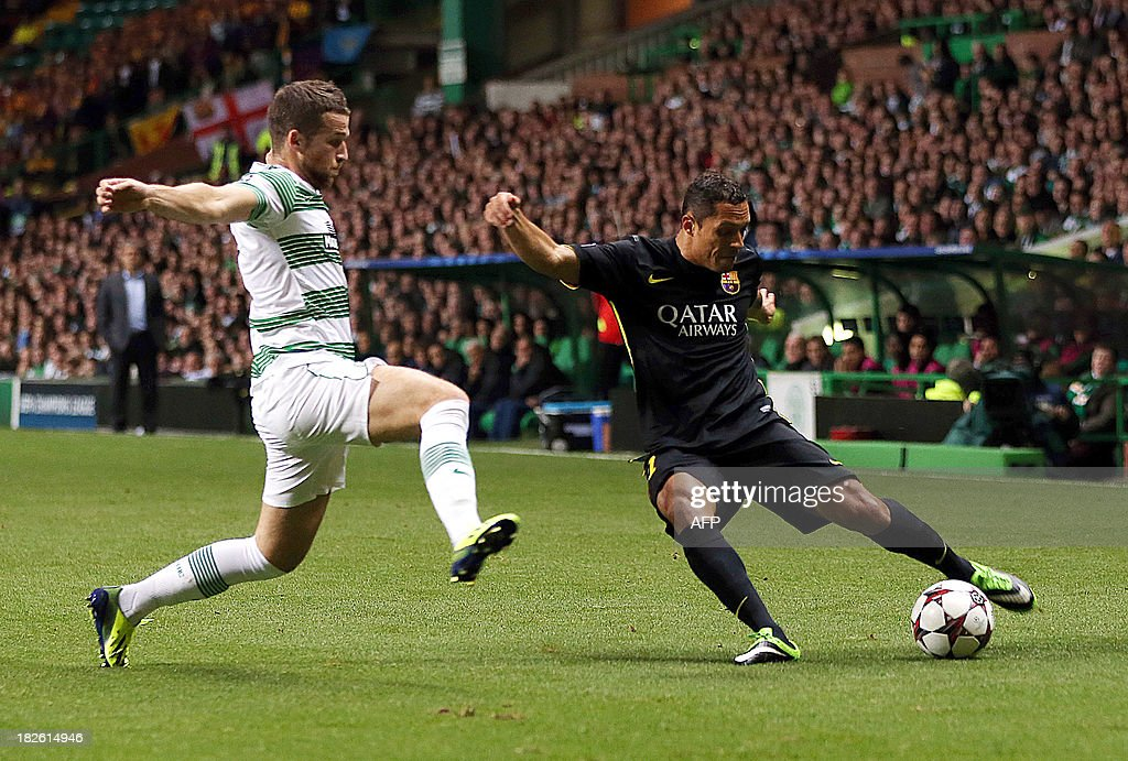 Celtic's Welsh defender Adam Mathews vies with Barcelona's Brazilian defender Adriano during their UEFA Champions League Group H football match at Celtic Park in Glasgow on October 1, 2012.