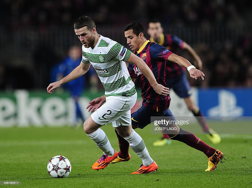 Celtic's Welsh defender Adam Matthews (L) vies with Barcelona's Chilean forward Alexis Sanchez (R) during the UEFA Champions League Group H football match FC Barcelona vs Celtic FC at the Camp Nou stadium in Barcelona on December 11, 2013.